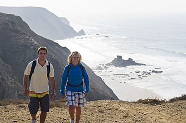 Portugal, Man and woman hiking on mountain - MIRF000478