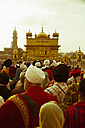 India, Punjab, Amritsar, People waiting at entry of Golden Temple - MBE000348