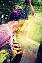 India, Ahmedabad, Young man celebrates Holi festival - MBE000355
