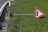 Germany, Bavaria, Bumps ahead sign lying on grass - TCF002721