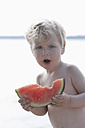 Germany, Bavaria, Boy eating watermelon, close up - TCF002738