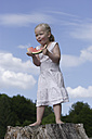 Germany, Bavaria, Girl eating piece of watermelon - TCF002772