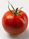 Wet tomato on white background, close up - KSWF000861