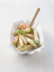 Asparagus chips with parsley and tomato dip in plate - KSWF000949