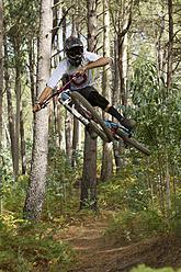 Portugal, Madeira, Mature man riding mountain bike - FFF001313