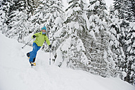 Austria, Salzburg County, Young woman snowshoeing - HHF004272