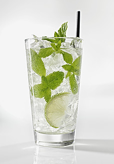 Glass of mojito with mint on white background, close up - KSWF000993