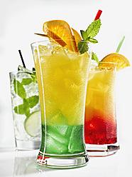 Glasses of iced orange juice, tequila sunrise and mojito on white background - KSWF000987