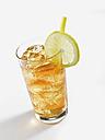 Glass of lemon ice tea on white background - KSWF000985