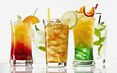 Glasses of cocktail with straw and fruit on white background - KSWF000983
