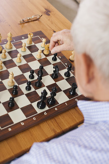 Germany, Leipzig, Senior man playing chess game - WESTF018756