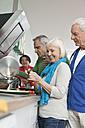 Germany, Leipzig, Senior men and women cooking food - WESTF018894