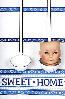 Soup ladles, doll's head and kitchen cloth, close up - LRF000546