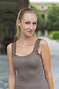 Germany, Bavaria, Munich, Young woman smiling, portrait - TCF002804