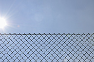 Germany, View of cyclone fence - AXF000132