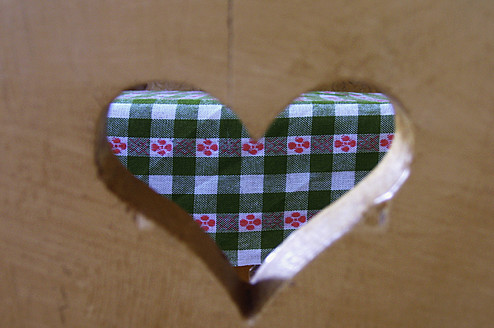 Germany, Bavaria, Munich, Table cloth seen through heart shaped hole in chair - AXF000145