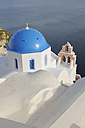 Greece, View of whitewashed church and bell tower at Oia village - RUEF000933