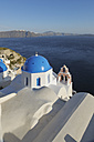 Greece, View of whitewashed church and bell tower at Oia - RUEF000953