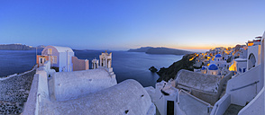 Greece, View of Oia village with bell tower of Greek Orthodox Church at Santorini - RUEF000958
