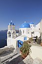 Greece, View of whitewashed church and bell tower at Oia - RUEF000963