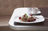 Chocolate icecream with raspberry, espresso in background - KSWF001001