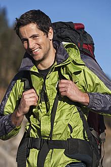 Germany, Portrait of mid adult man, smiling - RDF000994