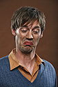 Germany, Young man making funny faces, close up - RDF001018