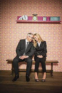 Germany, Stuttgart, Business couple sitting on bench, smiling - MFP000151
