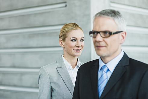 Germany, Stuttgart, Business people in office lobby,  smiling - MFPF000226