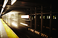 USA, New York, Train passing through subway station - TL000684