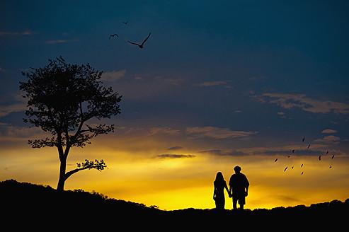 Couple in love at romantic landscape - ABAF000137