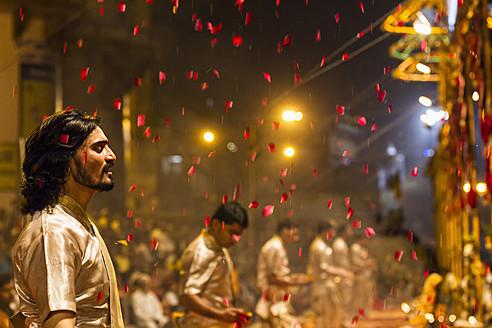 India, Uttar Pradesh, Priests celebrating River Ganges Aarti - FO004177