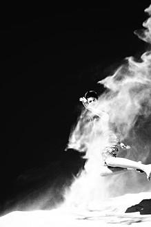 France, Teenage boy jumping on sand dune - MS002711