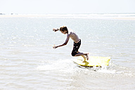 France, Boy surfing at Atlantic coast - MSF002716