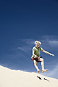 France, Boy jumping on sand dune - MSF002746