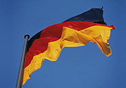 German Flag against blue sky - WBF001372