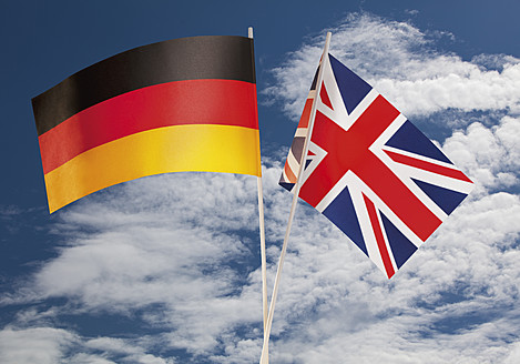 English flag and German flag against cloudy sky - WBF001375
