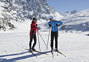 Germany, Man and woman skiing in snow - WBF001401