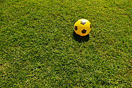 Italy, Soccer ball on grass - KAF000005
