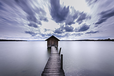 Germany, Bavaria, View of boathouse with pier at Ammersee Lake - MBOF000002