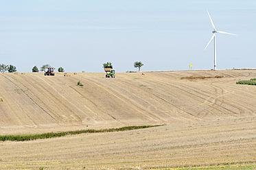 Germany, Saxony, View of wind wheel in corn field - MJF000061
