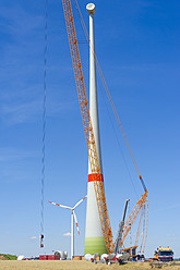 Germany, Saxony, Construction of wind turbine with crane - MJ000065