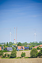 Germany, Saxony, View of wind turbine with solar panel in wind park - MJ000082