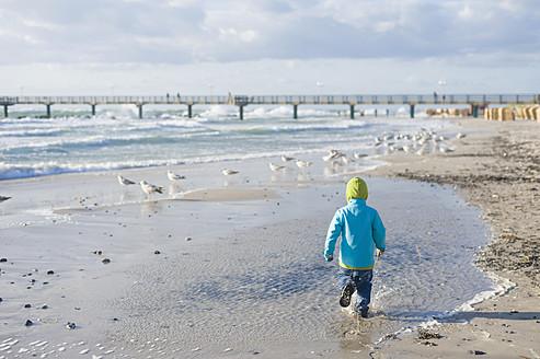 Germany,  Mecklenburg Western Pomerania, Boy running on Baltic Sea - MJF000112