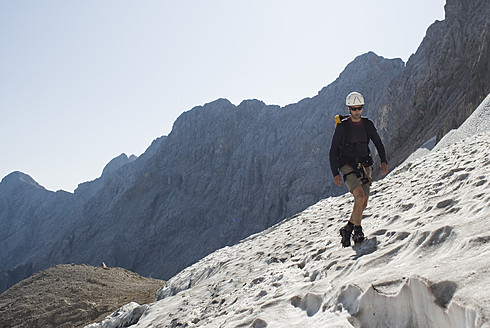 Germany, Bavaria, Man climbing mountain - KAF000019