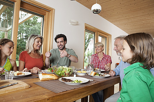 Germany, Bavaria, Nuremberg, Family having lunch together - RBYF000148