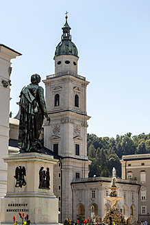 Austria, Salzburg, View of Mozart Square and statue of Mozart, Salzburg Cathedral in background - EJWF000031