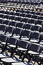 Austria, Salzburg, Empty chairs before event at Kapitelplatz - EJWF000038