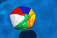 Austria, linz, Broken beach ball floating in swimming pool - EJWF000069