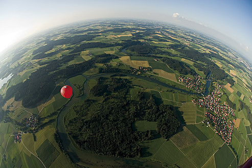 Germany, Bavaria, View of hot air balloon over pasture landscape - GNF001239